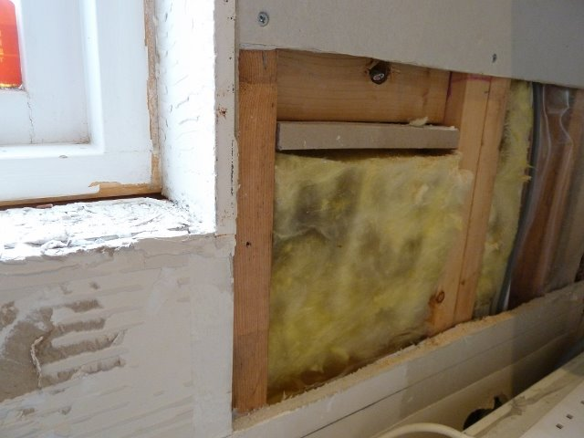 Old kitchen tiles removed and wiring pulled through for appliances.